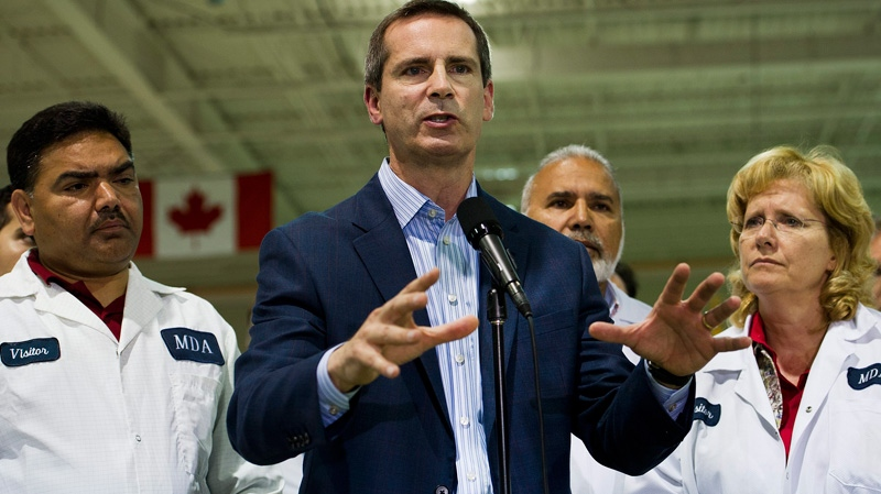 Ontario Liberal Leader Dalton McGuinty speaks to the media after touring the space engineering company MDA, during a campaign stop in Brampton, Ont., on Wednesday, Sept. 28, 2011.  (Nathan Denette / THE CANADIAN PRESS)