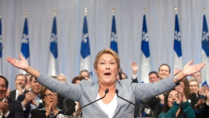 Parti Quebecois leader Pauline Marois speaks to delegates during a general council meeting in Laval, Que., Saturday, March 8, 2014 on day four of the Quebec provincial election campaign. (THE CANADIAN PRESS / Graham Hughes)