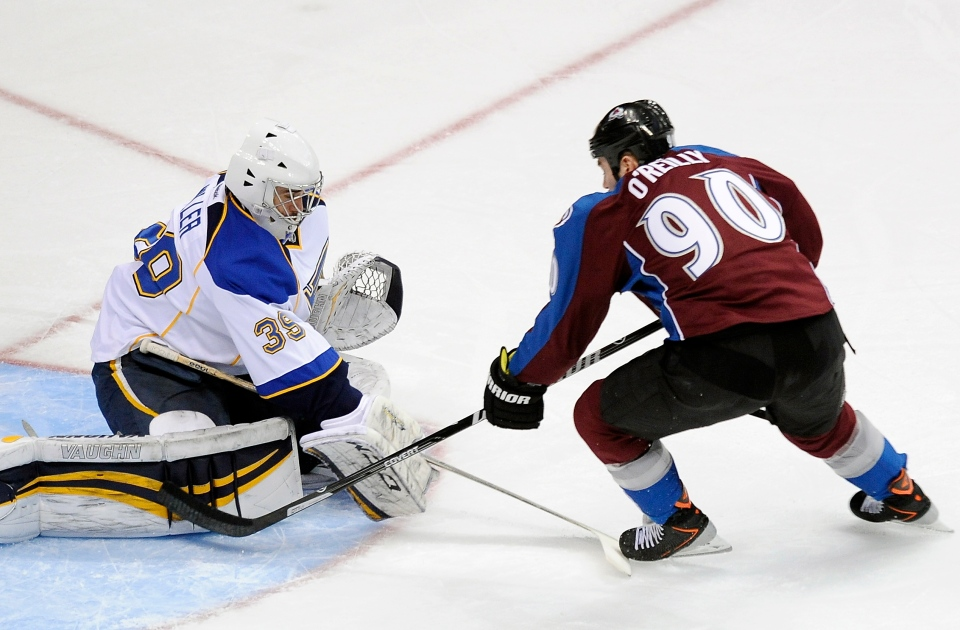 St. Louis Blues goalie Ryan Miller, left, stops a breakaway by Colorado Avalanche center Ryan O'Reilly, right, in the first period of an NHL hockey game on Saturday, March 8, 2014, in Denver. (AP / Chris Schneider)