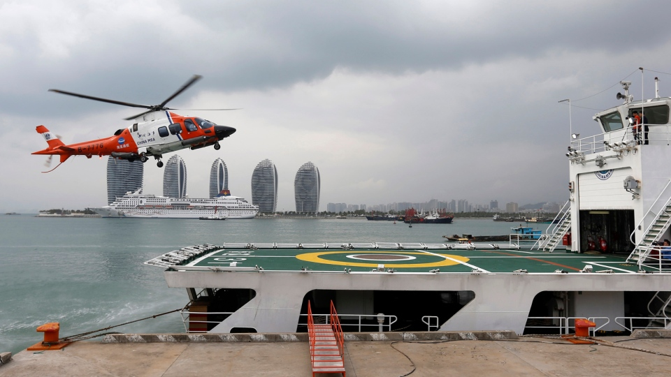 A helicopter prepares to land onboard the China Maritime Safety Administration (MSA) ship Haixun-31 during a brief stop in Sanya in southern China's Hainan province, Sunday, March 9, 2014. (AP Photo)