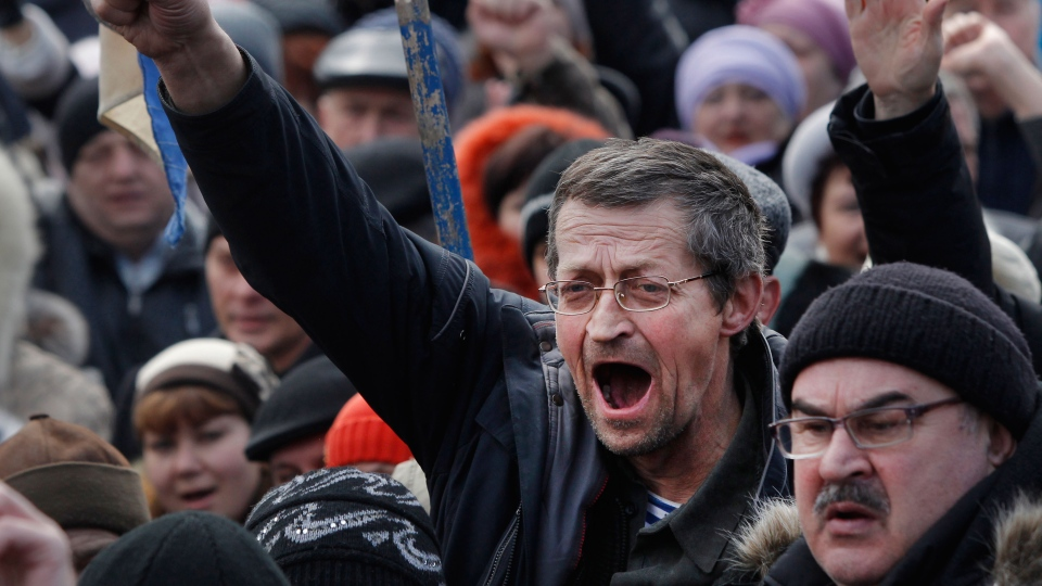 People shout slogans and gesture during a pro Russia rally at a central square in Donetsk, eastern Ukraine, Sunday, March 9, 2014. (AP / Sergei Grits)