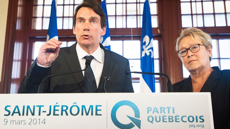 Parti Quebecois leader Pauline Marois looks on as Pierre Karl Peladeau gestures during a press conference in Saint Jerome, Que., Sunday, March 9, 2014. (Graham Hughes / THE CANADIAN PRESS)