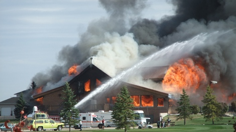 Fire crews battle a blaze at the Aspen Links COuntry Club in Emerald Park on Wednesday.