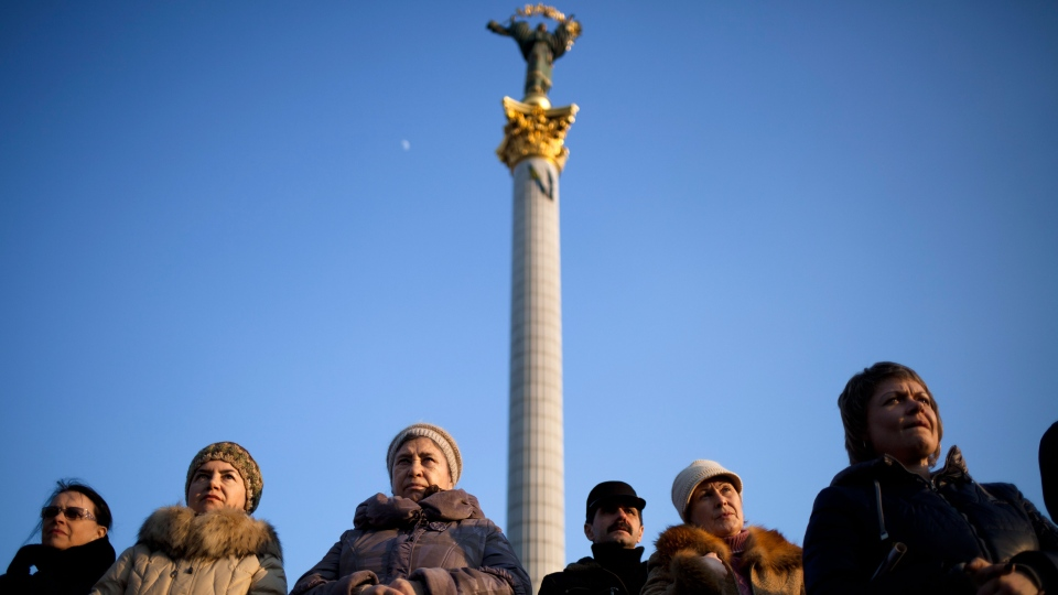 Ukrainians sing attend commemorations for writer and Ukrainian nationalist Taras Shevchenko in Kyiv's Independence Square, Ukraine, Sunday, March 9, 2014. (AP / David Azia)