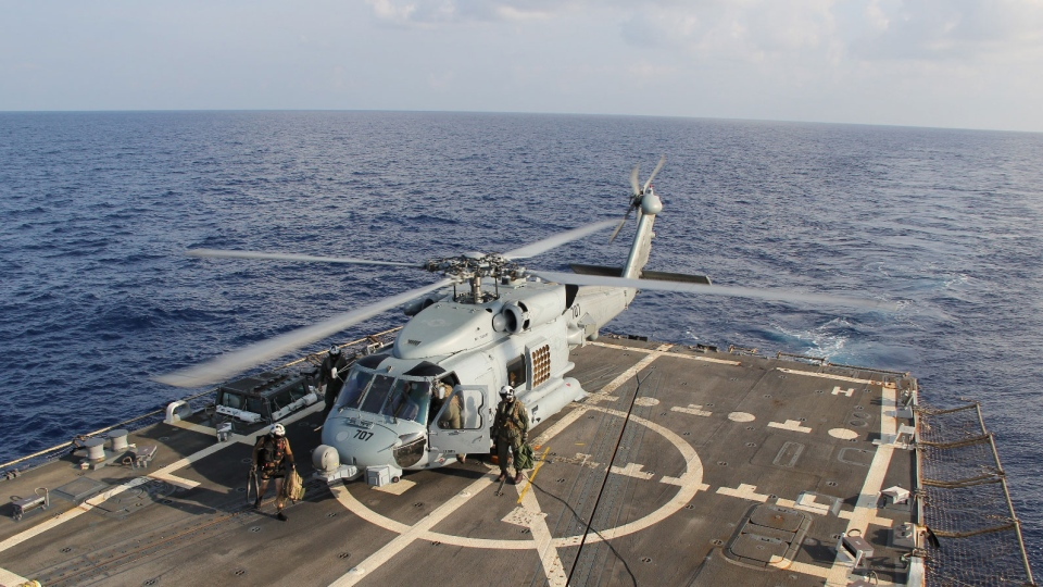 A U.S. Navy helicopter lands aboard USS Pinckney during a crew swap before returning to a search and rescue mission for the missing Malaysian airlines flight MH370 in the Gulf of Thailand, Sunday, March 9, 2014. (U.S. Navy Media Content Service / Senior Chief Petty Officer Chris D. Boardman)