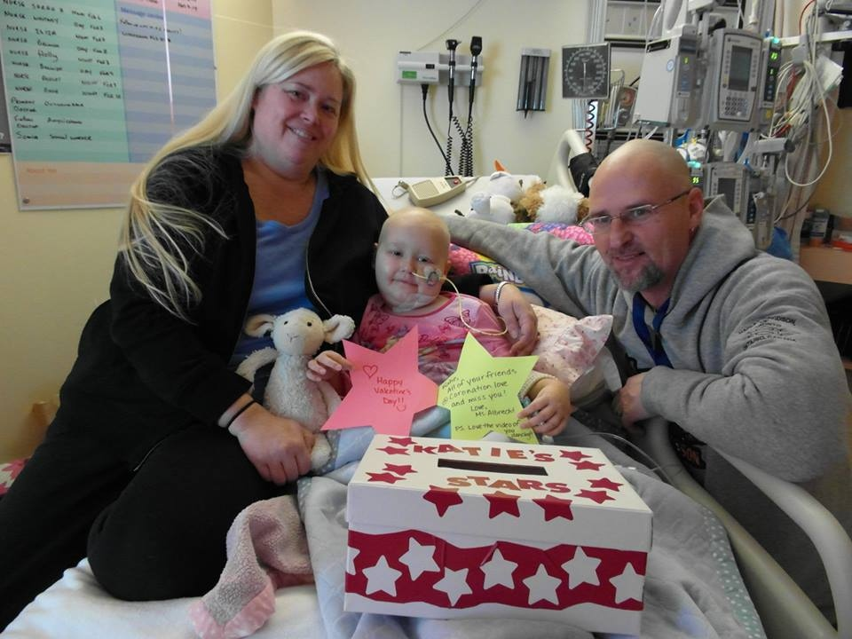 Katie Herron and her parents are seen in this photo taken from the 'Hope for Katie Star' Facebook page.