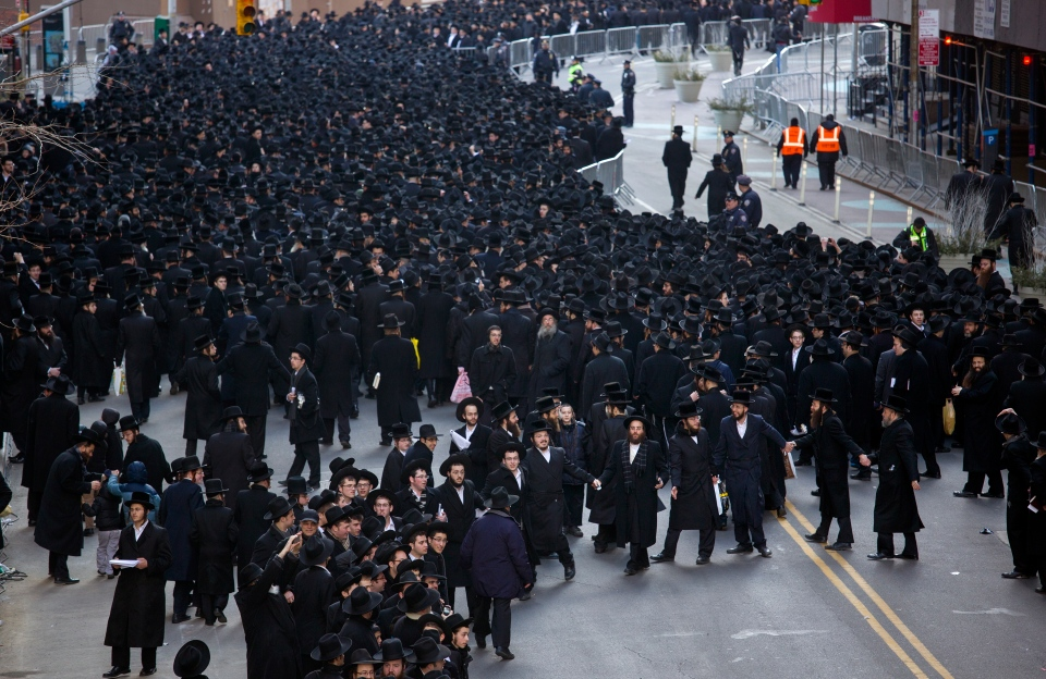 Thousands of Orthodox Jews gathered in New York, Sunday, March 9, 2014, on Water Street in lower Manhattan, to pray and protest against the Israeli government's proposal to pass a law that would draft strictly religious citizens into its army. (AP Photo/Craig Ruttle)