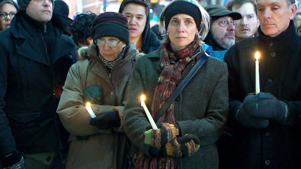 A vigil is held for Canadian photojournalist Ali Mustafa in Toronto, Ont. on Sunday, March 9, 2014.