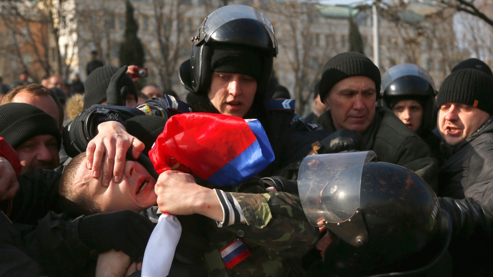 Ukrainian police detain a demonstrator during a pro Russian rally in Donetsk, Ukraine, Sunday, March 9, 2014. (AP / Sergei Grits)