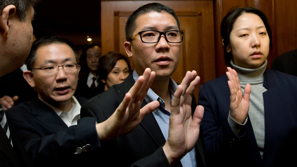 CEO of Malaysia Airlines Ignatius Ong, center, gestures as he prepares to speak to the media outside a hotel room for relatives or friends of passengers aboard a missing Malaysia Airlines airplane in Beijing, China Monday, March 10, 2014. (AP / Andy Wong)