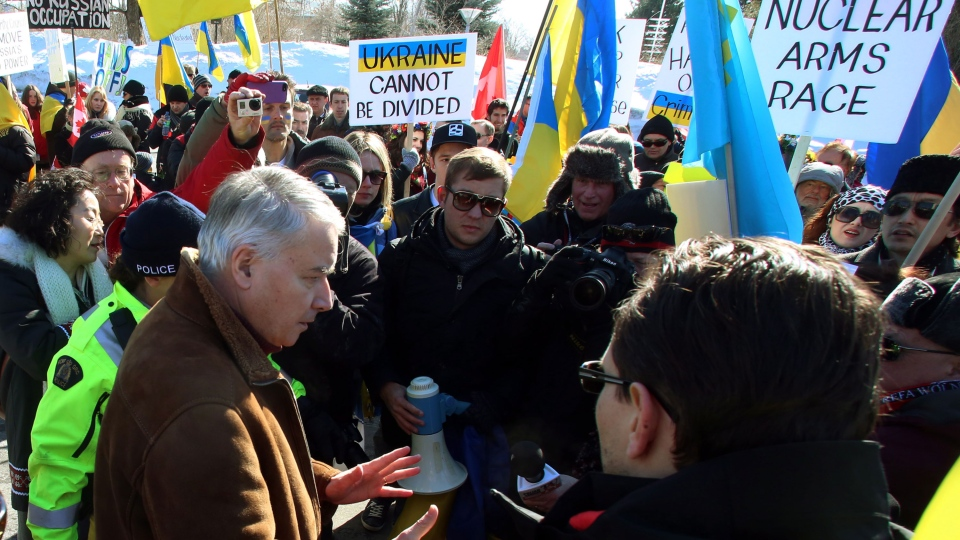 Phillipe Zeller (left) France's Ambassador to Canada meets with members of the Canadian Ukrainian community demonstrating outside the French embassy in Ottawa on Sunday March 9, 2014. (Fred Chartrand / THE CANADIAN PRESS)