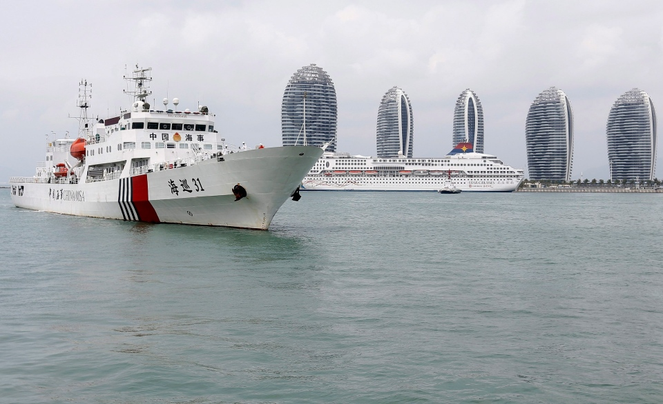 The China Maritime Safety Administration (MSA) ship Haixun-31 leaves after a brief stop in Sanya in southern China's Hainan province. The ship is joining an ongoing search for the missing Malaysian airline passenger plane that vanished. (AP Photo)