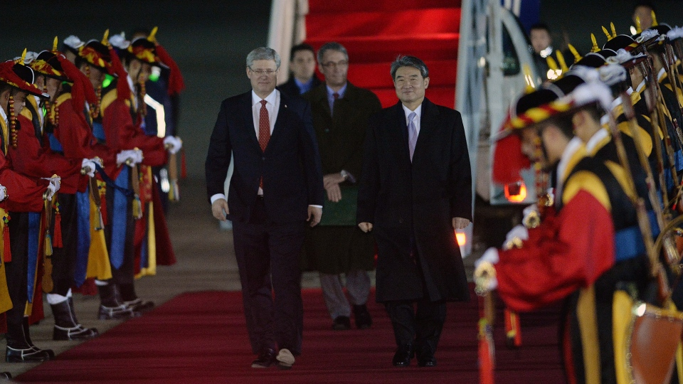 Prime Minister Stephen Harper walks with South Korean 1st Vice Minister of Foreign Affairs Cho Tae-Yong as he arrives in Seoul, South Korea on Monday, March 10, 2014. (Sean Kilpatrick / THE CANADIAN PRESS)