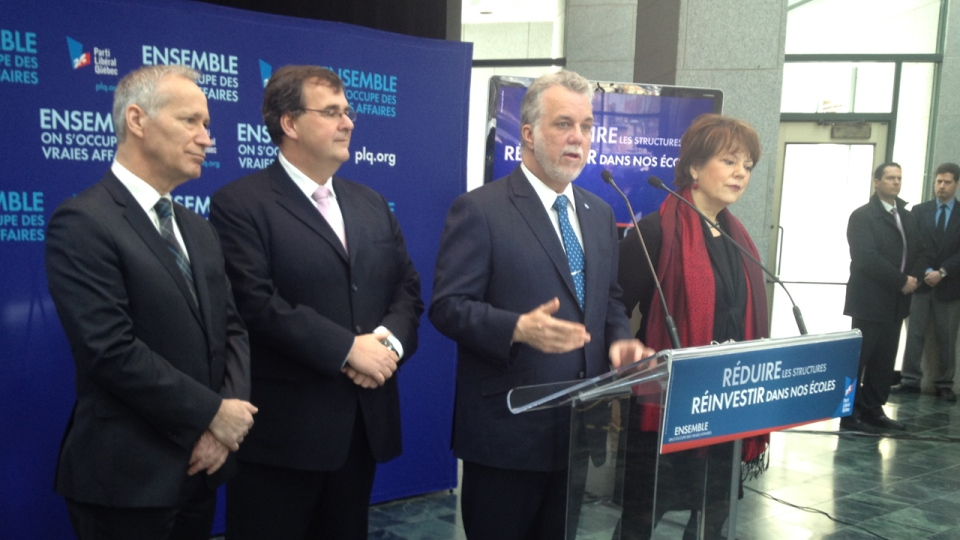 Surrounded by candidates, Liberal Leader Philippe Couillard speaks in Quebec City on March 10, 2014 (CTV Montreal, Frederic Bissonnette)