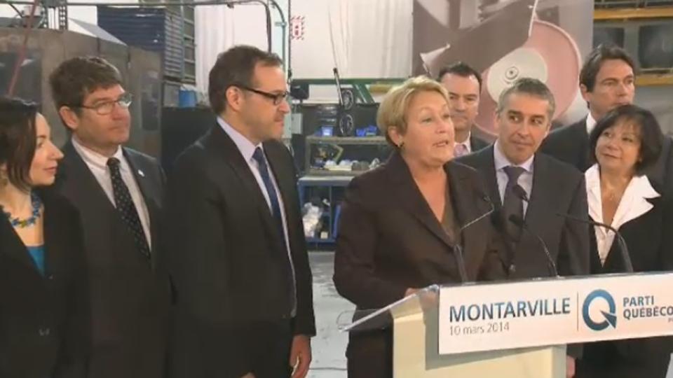 Pauline Marois with her economic team, including Pierre Karl Peladeau (March 10, 2014)