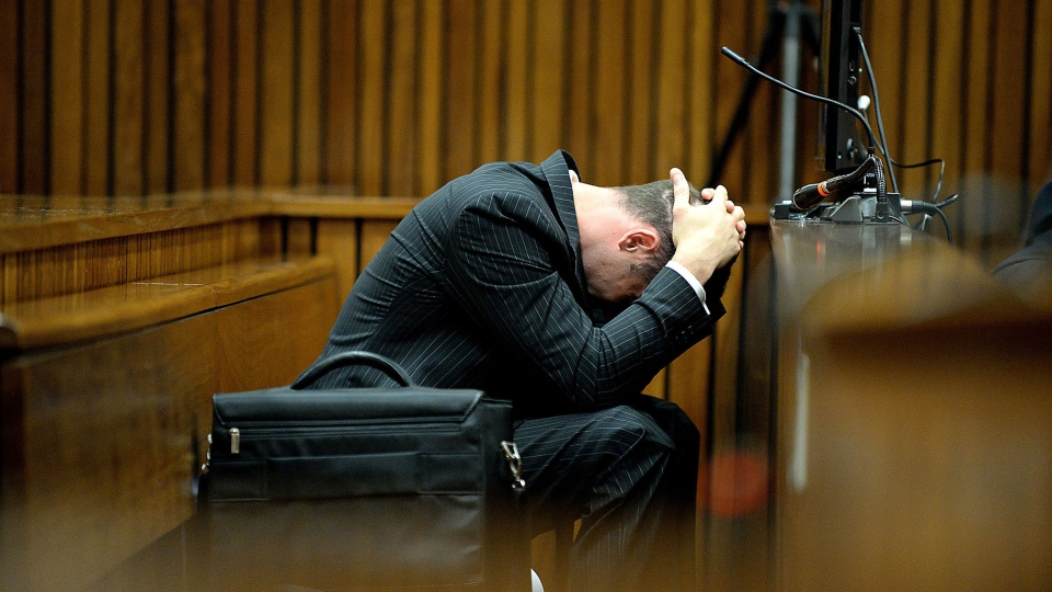 Oscar Pistorius buries his head in his hand as he listens to cross questioning, in the second week of his trial, about the events surrounding the shooting death of his girlfriend Reeva Steenkamp, in court during his trial in Pretoria, South Africa, Monday, March 10, 2014. (AP / Bongiwe Mchunu)