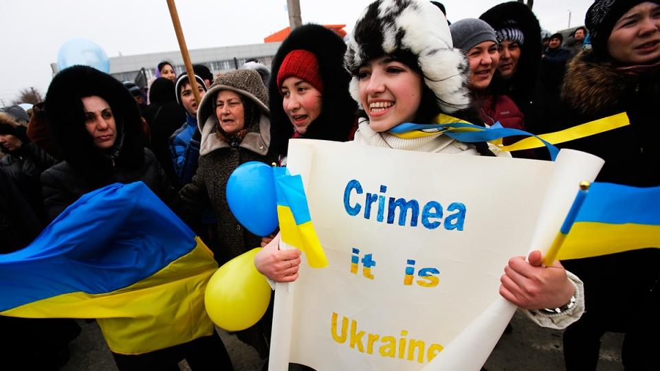 Crimean Tatars shout slogans during the pro-Ukraine rally in Simferopol, Crimea, Ukraine, Monday, March 10, 2014. (AP / Darko Vojinovic)