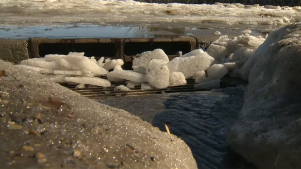Snow and ice obstruct a catch basin. (File photo)