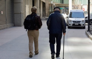 "First-year Northwestern University medical student Jared Worthington, left, walks with his ""Alzheimer's buddy,"" retired physician Dan Winship, in Chicago in this Feb. 28, 2014 photo. (AP / Teresa Crawford)"