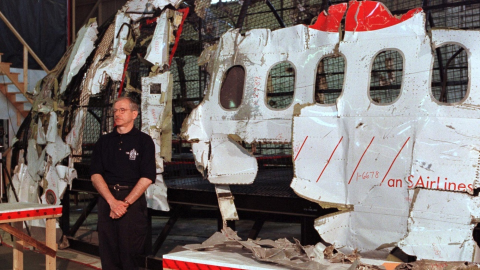 Transportation Safety Board of Canada chief investigator Vic Gerden stands stoically in front of the cockpit from Swissair Flight 111 at the reconstruction hangar at CFB Shearwater near Halifax, N.S. on Thursday May 27, 1999. (CP Photo/Andrew Vaughan)