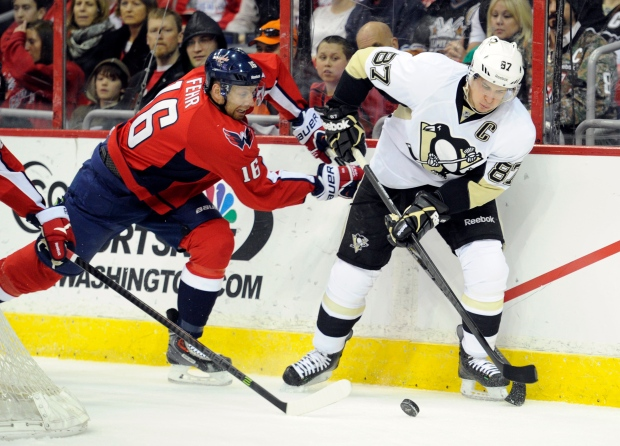 Eric Fehr fights for puck with Sidney Crosby