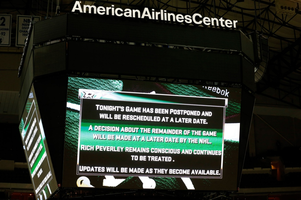 A notice is posted to fans about the postponement of the game and the condition of Dallas Stars centre Rich Peverly after play was suspended during an NHL Hockey game in Dallas, Monday, March 10, 2014. (AP / Sharon Ellman)