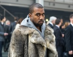 This Jan. 17, 2014 file photo shows singer Kanye West as he arrives for the Givenchy men's Fall-Winter 2014-2015 fashion collection in Paris. (AP Photo/Zacharie Scheurer, File)