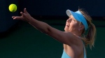 Maria Sharapova, of Russia, serves to Camila Giorgi, of Italy, during a third round match at the BNP Paribas Open tennis tournament in Indian Wells, Calif., on Monday, March 10, 2014. (AP / Mark J. Terrill)