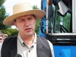 Farmer Michael Schmidt talks to reporters outside court in Newmarket, Ont on Thursday, July 31, 2008. (Colin Perkel / THE CANADIAN PRESS)