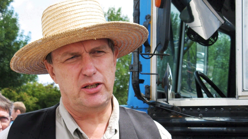 Farmer Michael Schmidt talks to reporters on Thursday July 31, 2008 outside court in Newmarket, Ont. (Colin Perkel / THE CANADIAN PRESS)