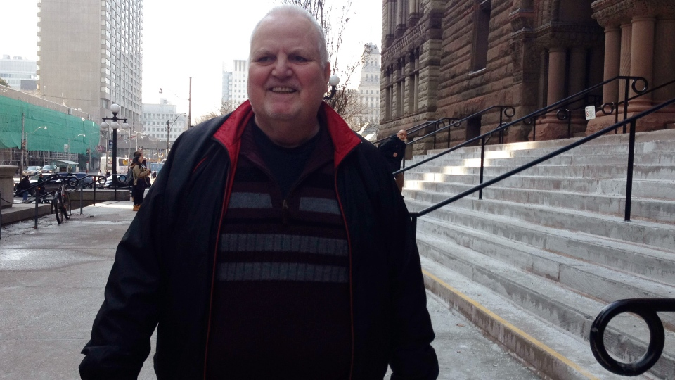 James Brunton walks out of the Old City Hall courthouse in Toronto on Tuesday, March 11, 2014.