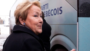 Parti Quebecois Leader Pauline Marois walks to her campaign bus following a news conference, in Becancour, Que., Tuesday, March 11, 2014. (Jacques Boissinot / THE CANADIAN PRESS)
