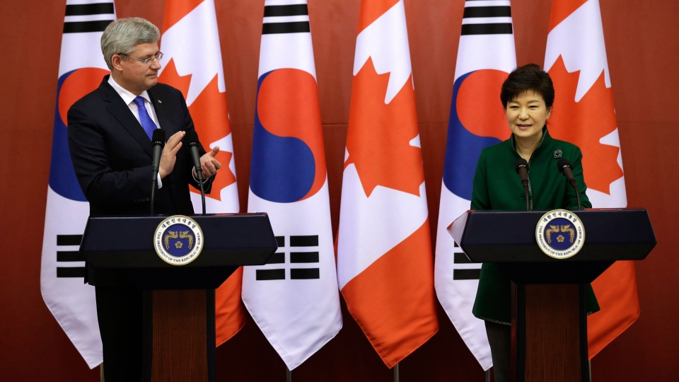 Canadian Prime Minister Stephen Harper, left, applauds while South Korean President Park Geun-hye delivers a speech during joint press conference after their meeting at the presidential Blue House in Seoul, South Korea, Tuesday, March 11, 2014. (AP / Lee Jin-man)