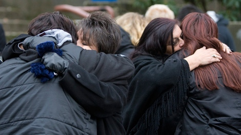Family members of some of the victims of murderer Robert Pickton hug outside the B.C. Supreme Court in New Westminster, B.C. Tuesday, Dec. 11, 2007. (Jonathan Hayward / THE CANADIAN PRESS)