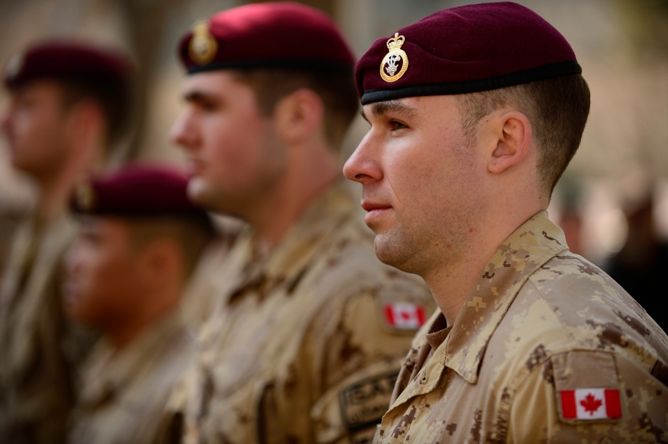 Master Cpl. Jordan Taylor, a member of the Canadian Contribution to the Training Mission in Afghanistan, stands on parade during the flag lowering ceremony at the International Security Assistance Force headquarters, Wednesday, March 12, 2014. (Master Cpl. Patrick Blanchard / Canadian Forces Combat Camera)