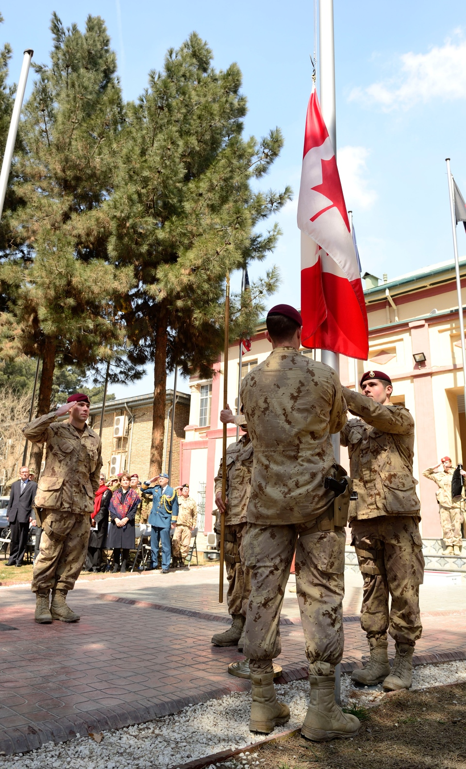 Master Cpl. Jordan Taylor salutes as the Canadian flag is lowered at the International Security Assistance Force headquarters, Wednesday, March 12, 2014. (Master Cpl. Patrick Blanchard / Canadian Forces Combat Camera)