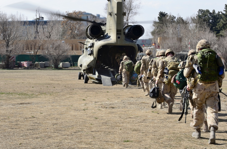 The last Canadians involved in the NATO training mission in Afghanistan board an American Chinook helicopter as they leave the International Security Assistance Force headquarters in Kabul, Afghanistan, Wednesday, March 12, 2014. (Master Cpl. Patrick Blanchard / Canadian Forces Combat Camera)