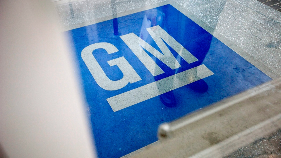 The logo for General Motors decorates the entrance at the site of a GM information technology center in Roswell, Ga. on Thursday, Jan. 10, 2013. (AP / David Goldman)