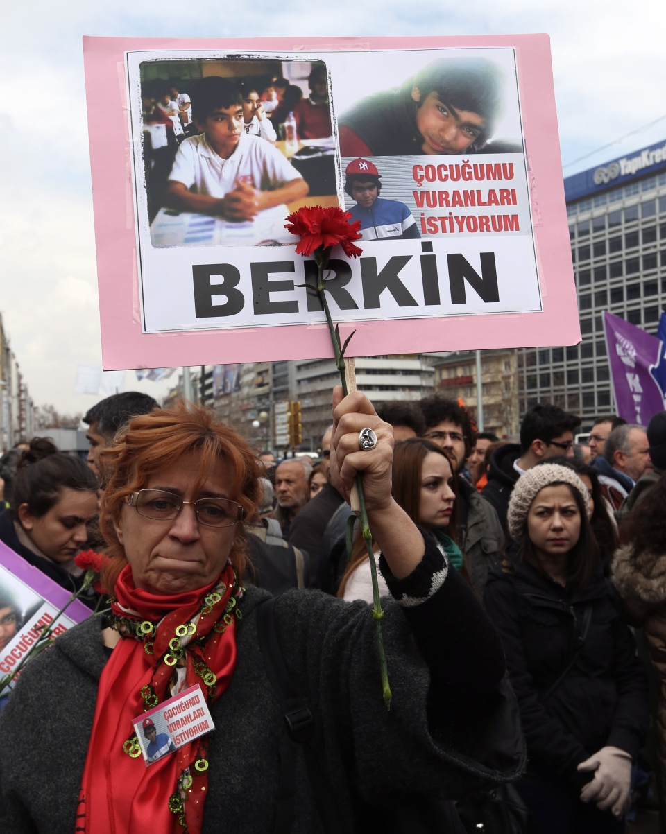 "A woman holds a poster of Berkin Elvan during a protest in Ankara, Turkey, Wednesday, March 12, 2014.""(AP Photo/Burhan Ozbilici)"