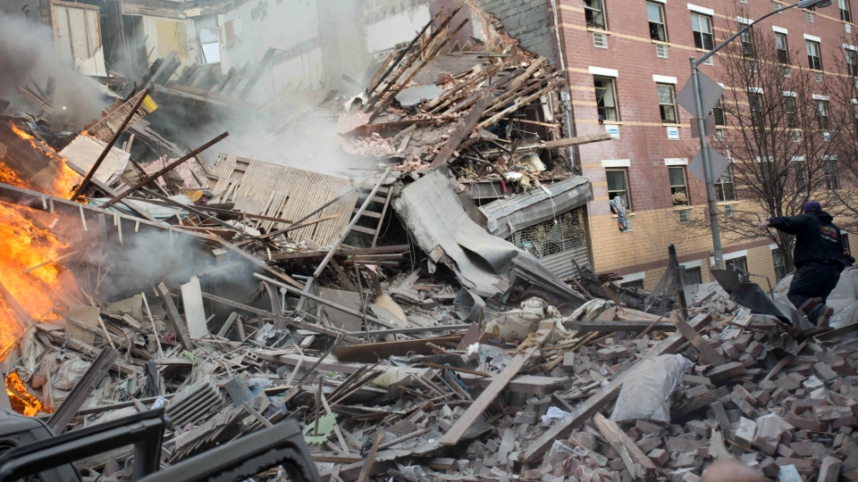 Emergency workers respond to the scene of an explosion and building collapse in the East Harlem neighbourhood of New York, Wednesday, March 12, 2014. (AP / Jeremy Sailing)