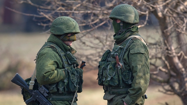 Pro-Russian soldiers stands outside the Ukrainian infantry base in Perevalne, Ukraine, Wednesday, March 12, 2014.(AP Photo/Vadim Ghirda)