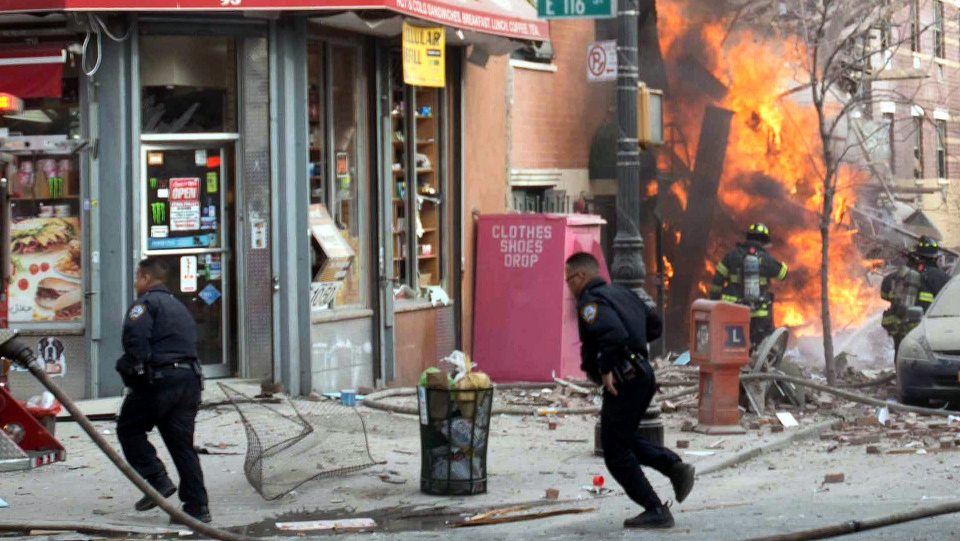 Emergency crews respond to an explosion that levelled two apartment buildings in the East Harlem neighbourhood of New York, Wednesday, March 12, 2014. (AP / Jeremy Sailing)