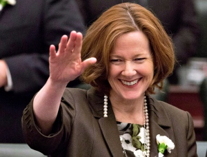 Alberta Premier Alison Redford waves to members of the legislative assembly before the throne speech at the Alberta Legislature in Edmonton, Alta., on Monday March 3, 2014. (The Canadian Press/Jason Franson)