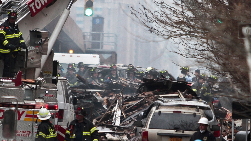 Firefighters continue to investigate and remove debris from an explosion in Harlem, Wednesday, March 12, 2014 in New York. (AP / Bebeto Matthews)