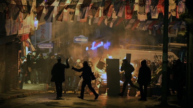 Demonstrators clash with riot police following the funeral of Berkin Elvan, who had been in a coma after a police tear-gas canister struck him in the head last year, in Istanbul, Turkey, Wednesday, March 12, 2014. (AP / Emrah Gurel)