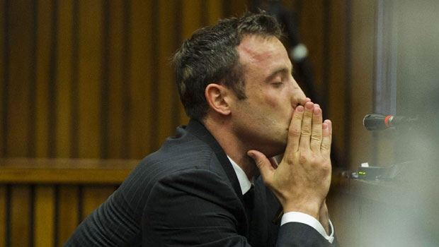 Oscar Pistorius covers his mouth with his hands as he listens to forensic evidence during his trial in court in Pretoria, South Africa, Thursday, March 13, 2014. Pistorius is charged with the shooting death of his girlfriend Reeva Steenkamp, on Valentines Day in 2013. (AP / Alet Pretorius)