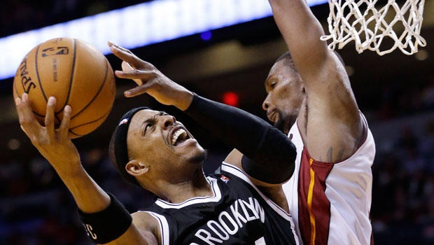 Brooklyn Nets forward Paul Pierce (34) goes up for a shot against Miami Heat center Chris Bosh (1) during the second half of an NBA basketball game, Wednesday, March 12, 2014, in Miami. Pierce scored 29 points in the game as the Nets defeated the Heat 96-95. (AP Photo/Wilfredo Lee)