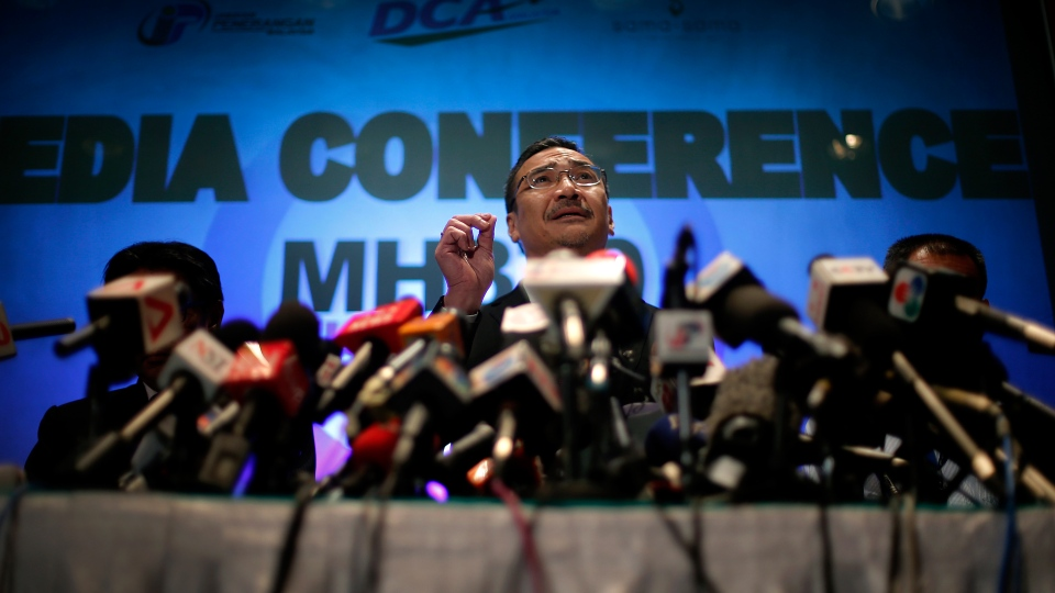 Malaysia's Minister of Transport Hishamuddin Hussein takes questions from the media during a press conference about the missing Malaysia Airlines jetliner MH370 in Sepang, Malaysia, Thursday, March 13, 2014. (AP / Wong Maye-E)