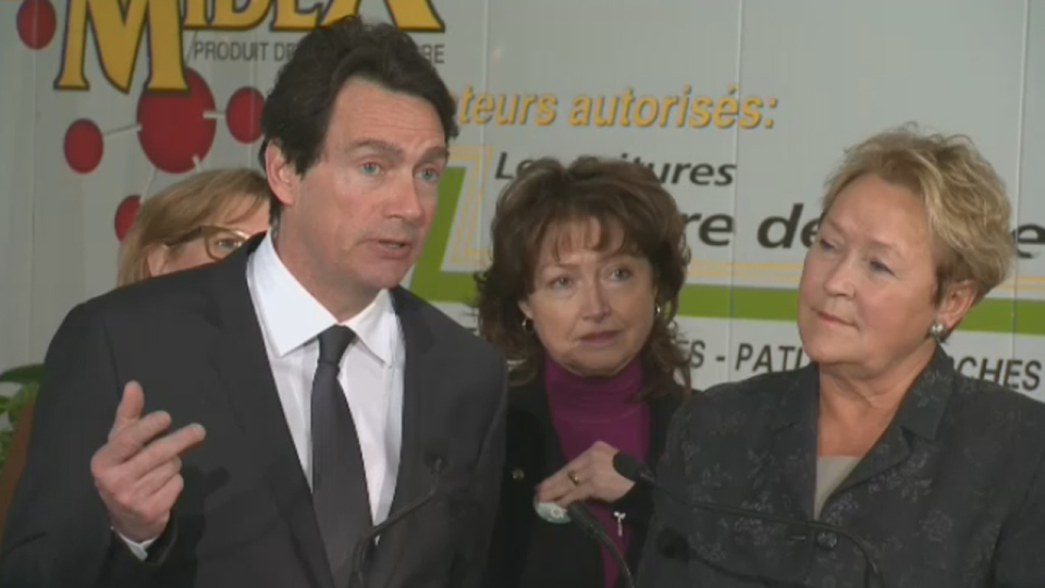 Pierre Karl Peladeau, Pauline Marois, and other PQ candidates make a campaign stop in Levis, Quebec (March 13, 2014)