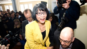 Olivia Chow walks on stage to officially enter into the race as a candidate in the up coming fall Toronto mayor election in Toronto on Thursday, March 13, 2014. (Nathan Denette / THE CANADIAN PRESS)